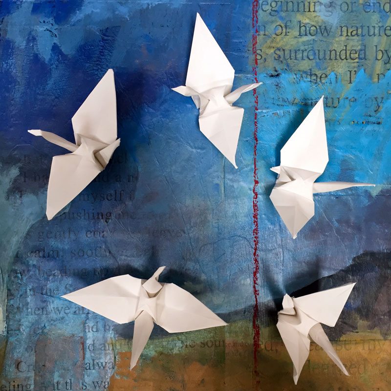 a flock of five origami cranes, crafted by dawn chandler