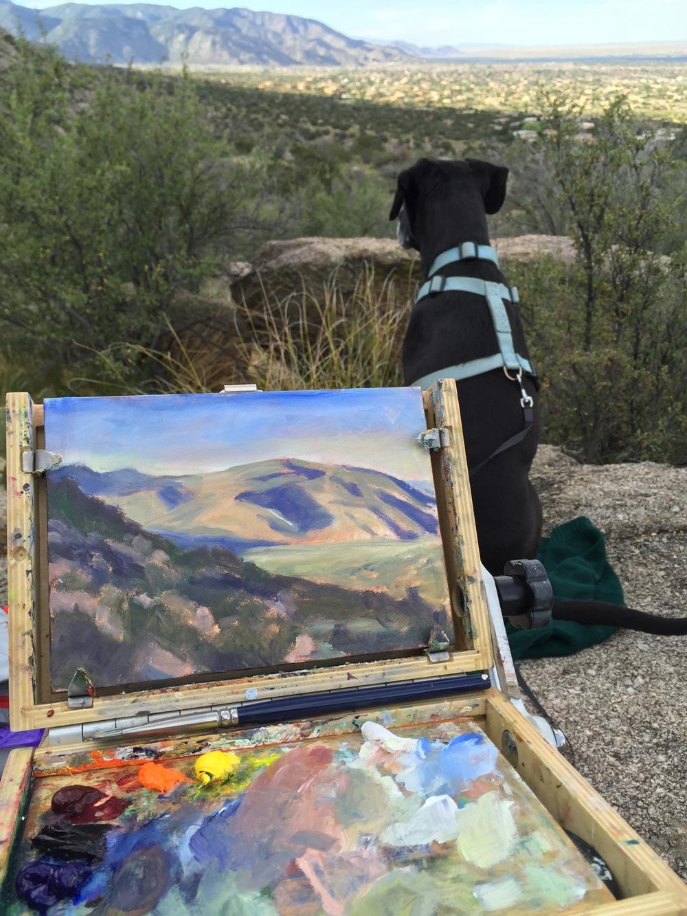 artist Dawn Chandler painting en plain air at la cueva picnic area above albuquerque with her brave companion standing guard