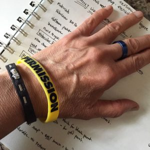 Dawn Chandler displaying her 'permission' bracelet from Bob Burridge's abstracting the figure class at the Sedona Art Center, May 2017
