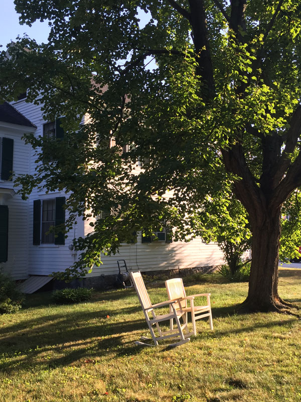 Two inviting yard rocking chairs at my aunt's home in Exeter, New Hampshire; photo by Dawn CHandler, Santa Fe artist