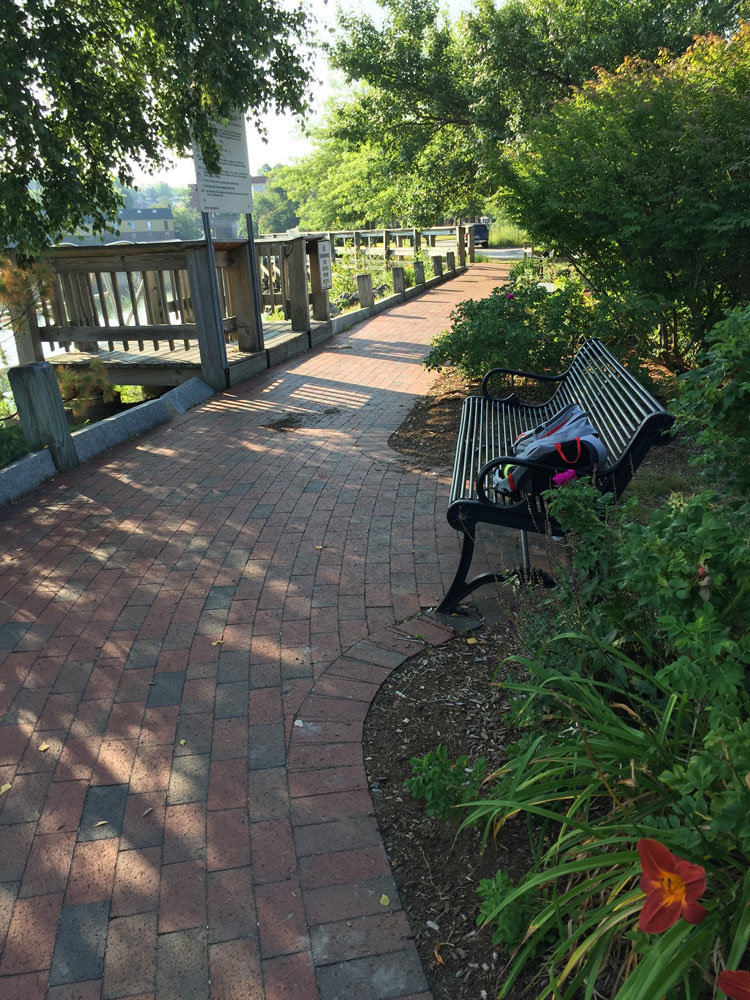 An inviting park bench along the Exeter RIver, in Exeter New Hampshire. Photo by Santa Fe artist Dawn Chandler
