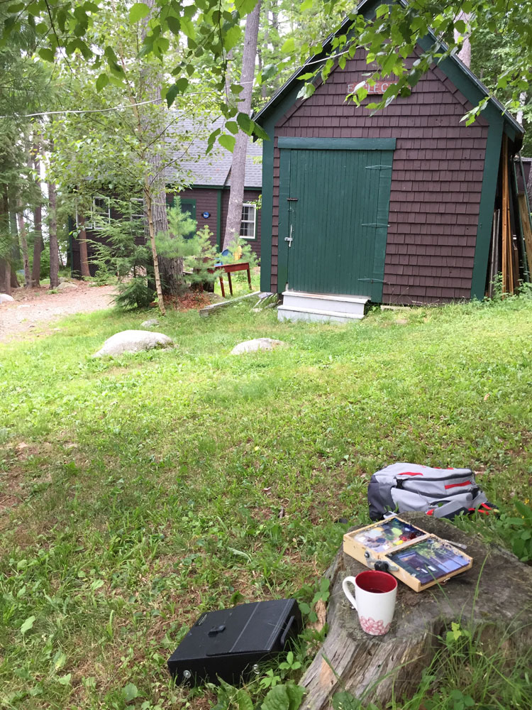 Artist Dawn Chandler's plein airt paint kit sits in front of her aunt's tool shed, now closed up in anticipation of rain, Lake Wentworth.