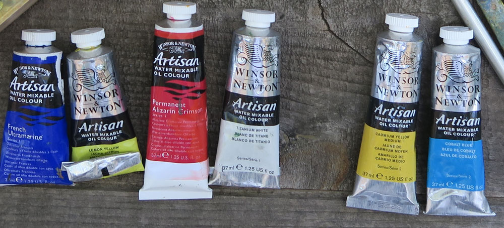 Tools of a traveling painter - Artist Dawn Chandler's limit palette paint selection when painting with water-mixable oil paints.