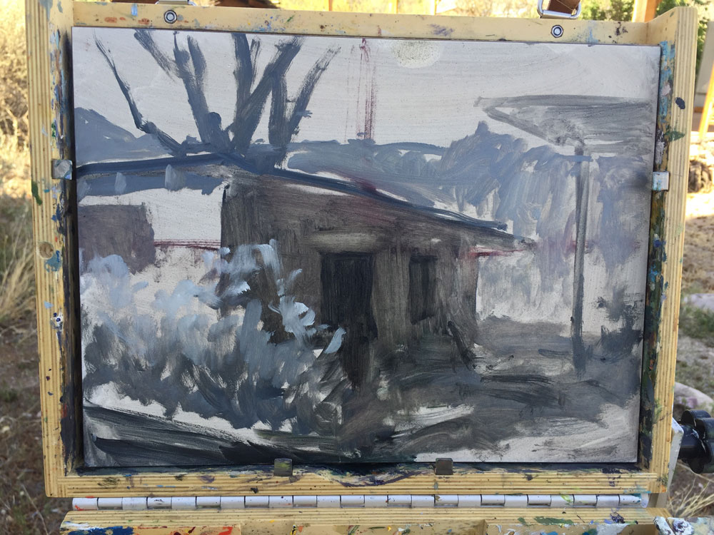 Dawn Chandler's laying in the values on a plein in painting of an adobe pottery shed in Dixon, New Mexico