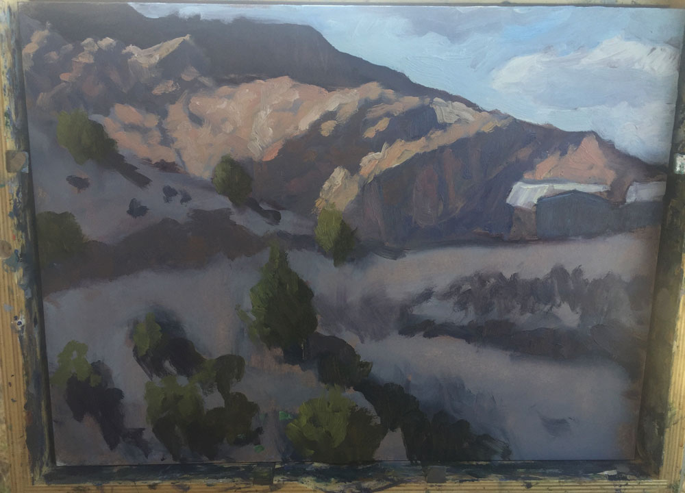 Dawn Chandler's starting to add color in a plein air painting of view in Dixon, New Mexico