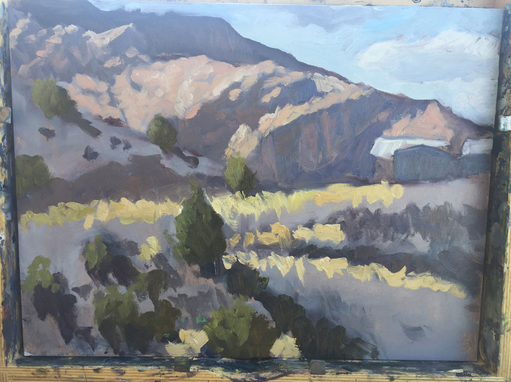 Dawn Chandler adding yet more color to a plein air painting of view in Dixon, New Mexico