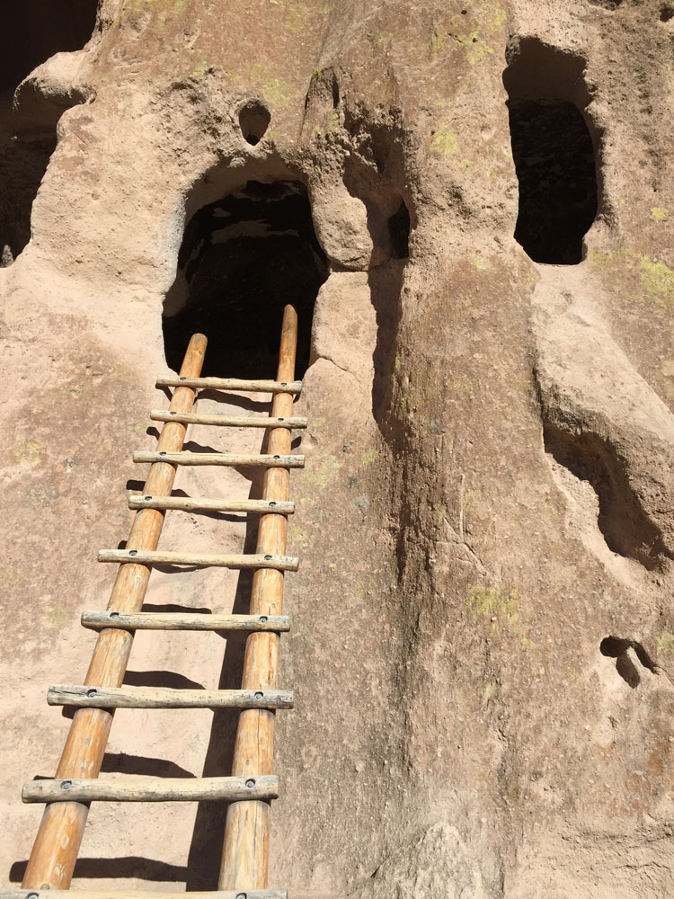 A ladder leading to an ancient dwelling at Bandelier National Monument as photographed by artist Dawn Chandler