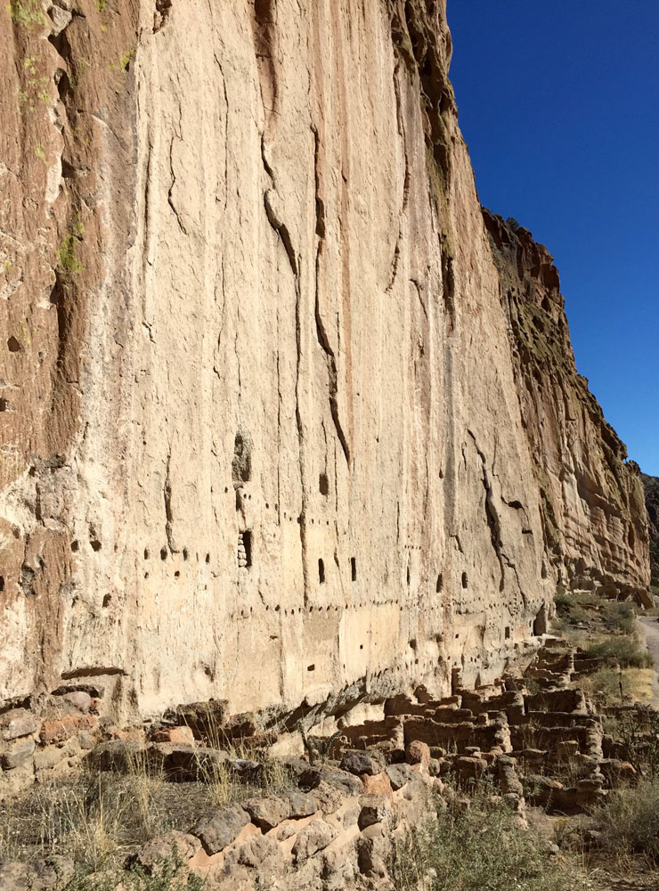 The tall cliffs and dwellings of Bandelier National Monument, photographed by artist Dawn Chandler