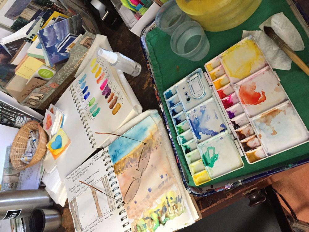 artist Dawn Chandler's watercolor palette and sketchbook