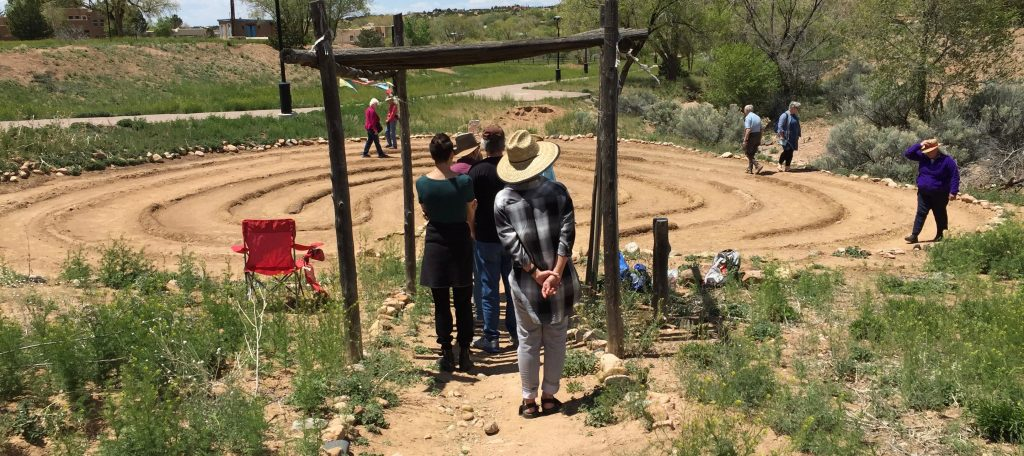 Neighbors gatherto walk the Frenchy's Park labyrinth in Santa Fe. Photo by Dawn Chandler.