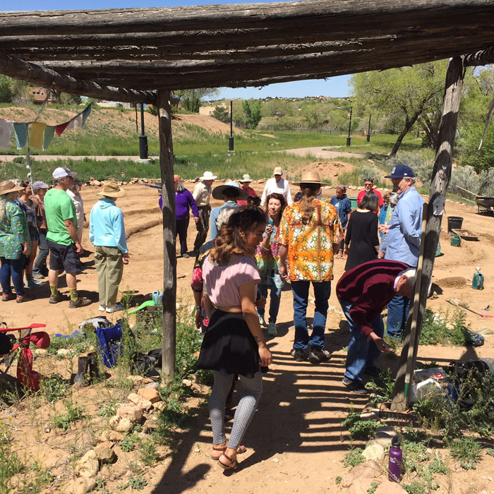 Volunteers and muscians gather for Mud Day at the Frenchy's Park labyrinth in Santa Fe. Photo by Dawn Chandler.