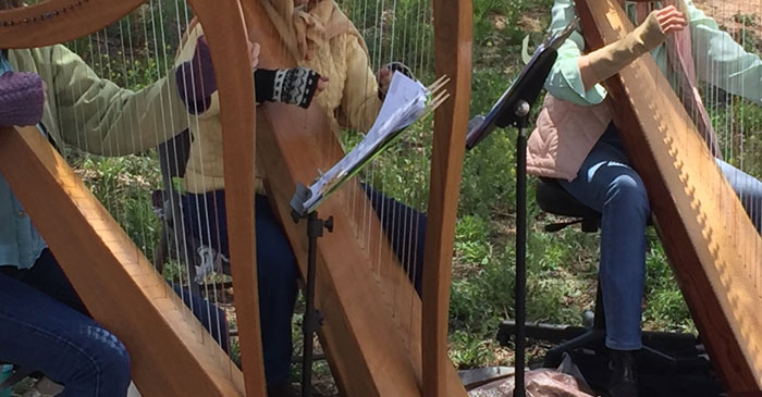 Harpists serenade the walking of the Frenchy's Park labyrinth in Santa Fe on Mud Day. Photo by Dawn Chandler.