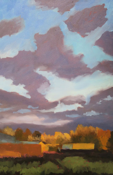 Dawn Chandler further developing the sky in her New Mexico landscape oil painting 'Santa Fe September.'