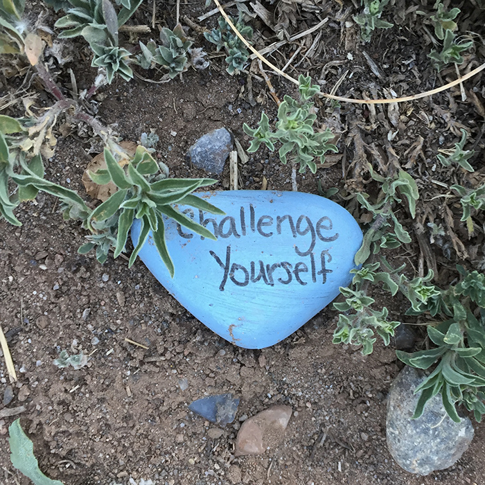 Challenge Yourself - Blue stone quotation art east side of the Sandias. Photo by Dawn Chandler.