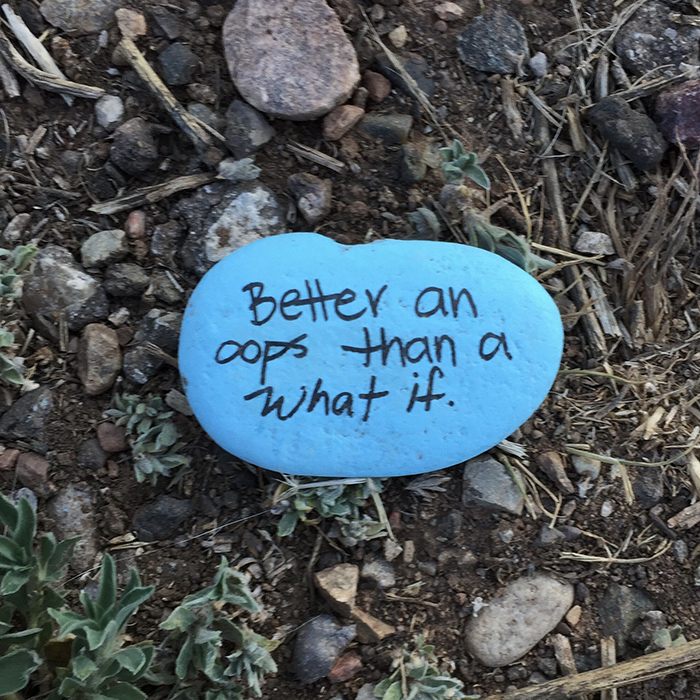 Better and oops than a what if. Blue stone quotation art east side of the Sandias. Photo by Dawn Chandler.