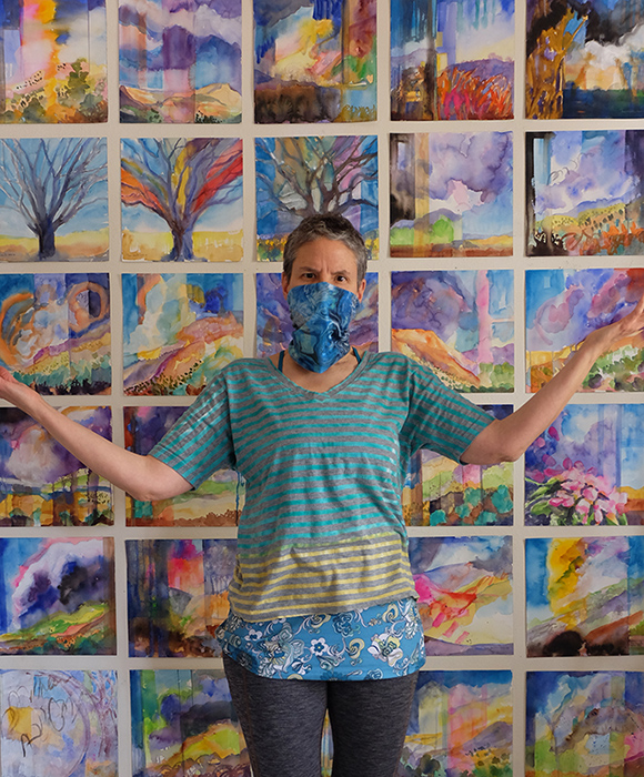 New Mexico artist Dawn Chandler proudly social distancing in her studio among her Watercolor Wanderings painting series.