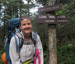 Artist and LT NOBO Thru-hiker Dawn 'TaosDawn' Chandler heading across the top of Mount Mansfield on Vermont's Long Trail.